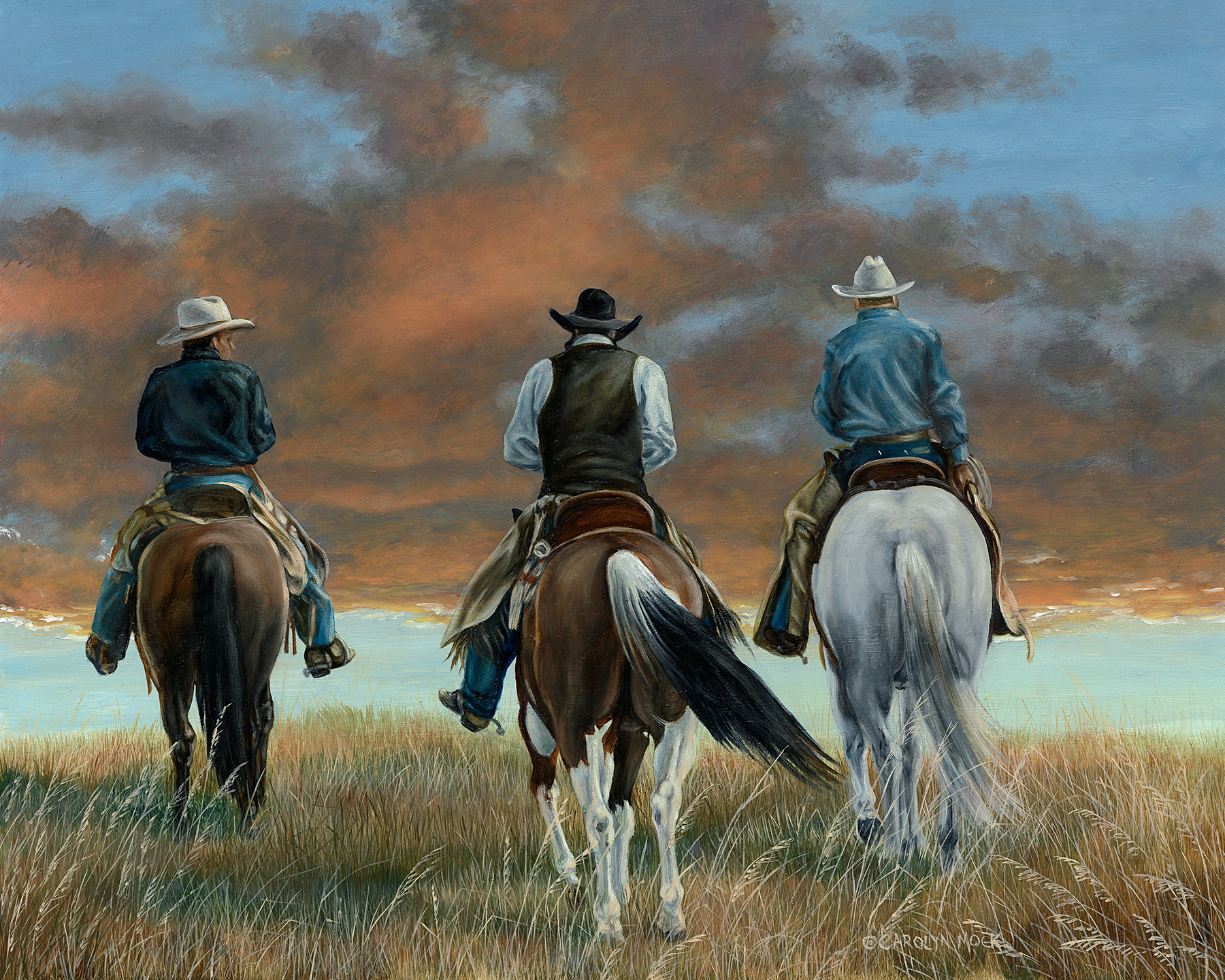 Three cowboys ride off into the sunset