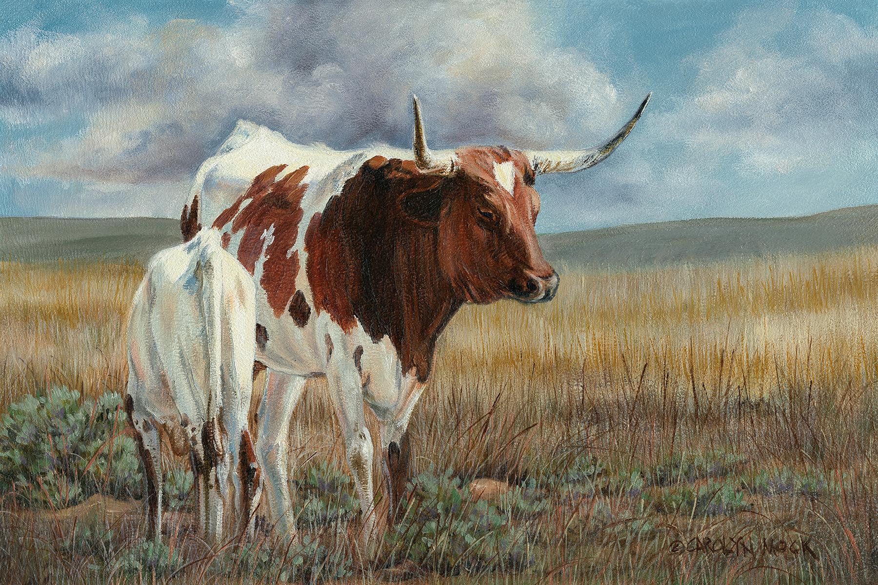 A longhorn and calf graze in a field