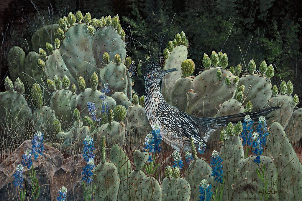 A small bird traverses a cactus patch