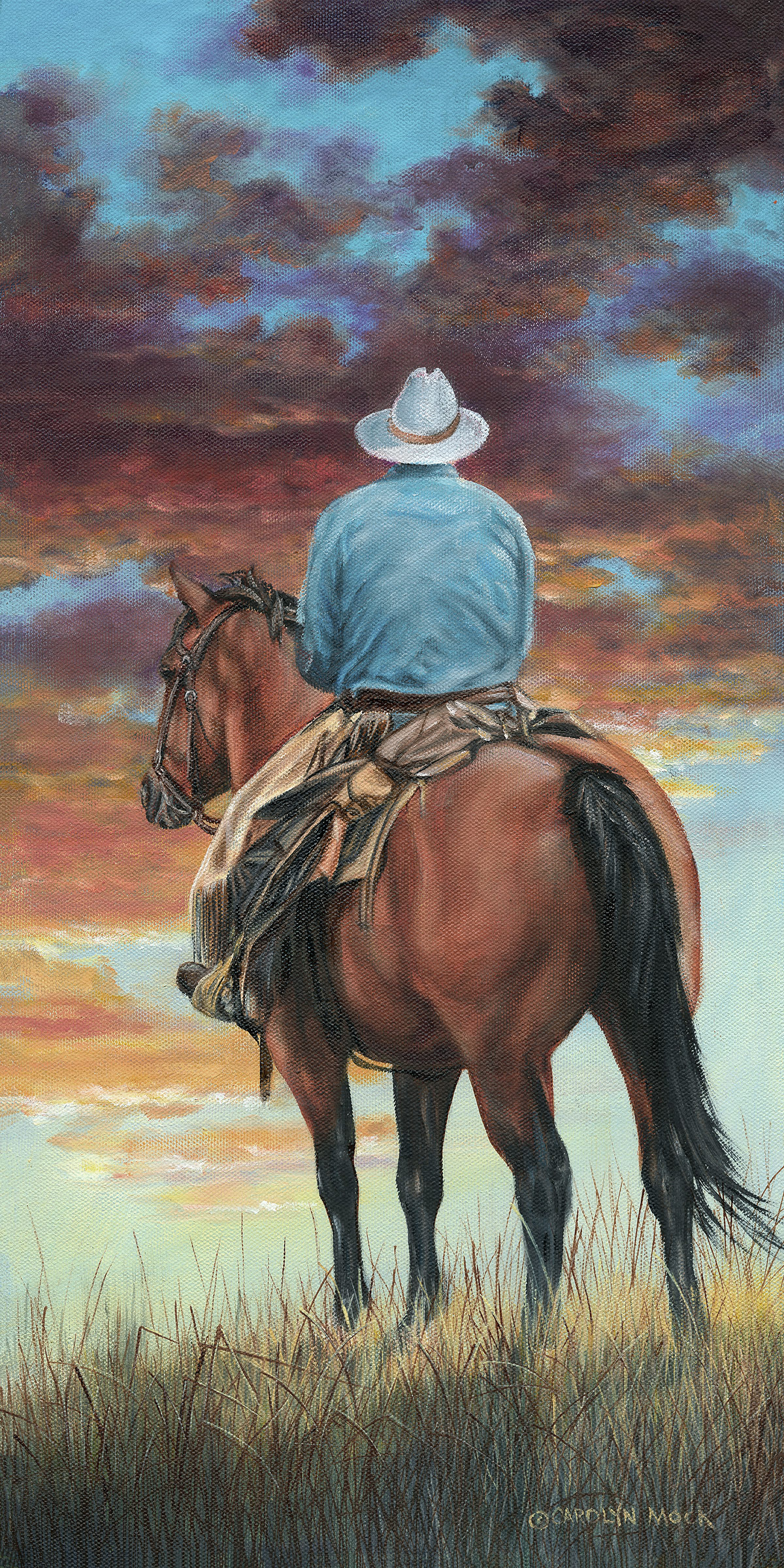 A cowboy rides into the sunset