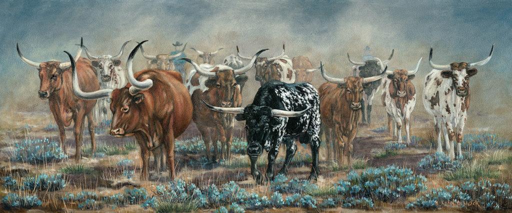 A herd of cattle stir up dust in a field