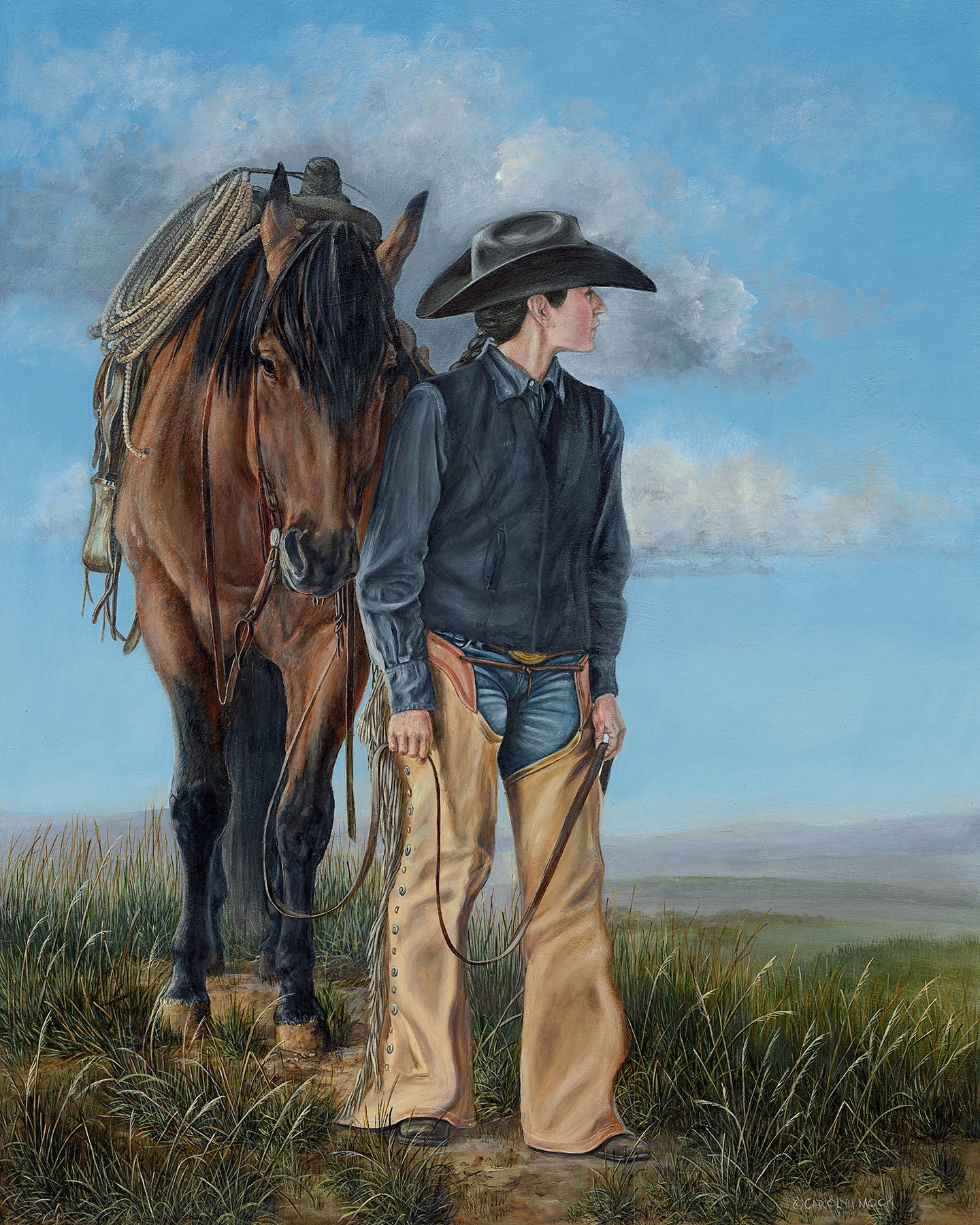 A cowboy with his horse looks to the horizon in an open field